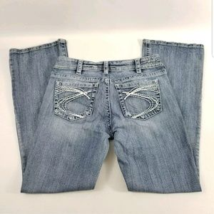 SILVER Suki Buckle Flap Pockets Boot Jeans Distres